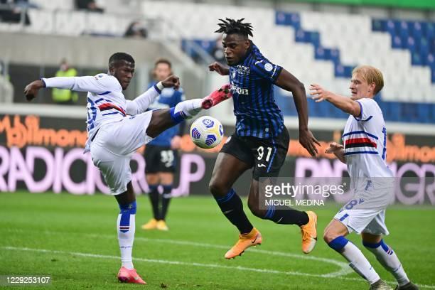 Spanish-born Senegalese Sampdoria's forward Keita Balde makes a fault on Atalanta's Colombian forward Duvan Zapata during the Italian Serie A...