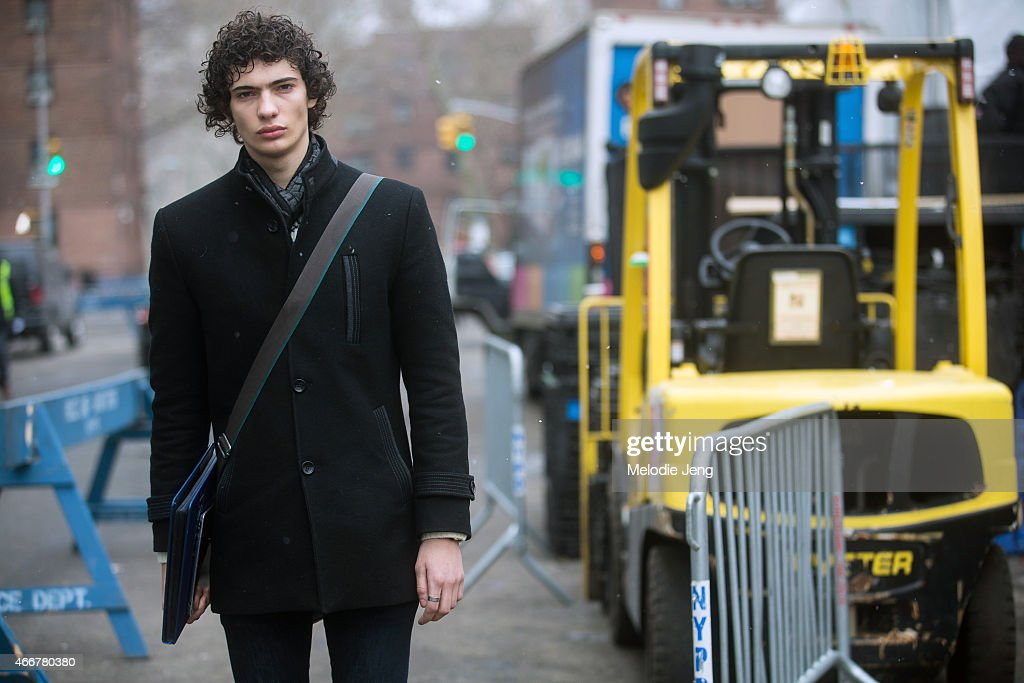 Spanish/Croatian male model Piero Mendez exits the Richard Chai show at Lincoln Center on February 12, 2015 in New York City.