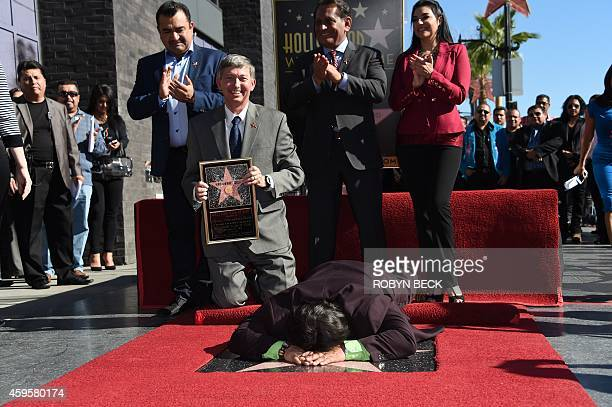 Spanishlanguage radio personality Renán Almendárez Coello 'El Cucuy de la Manana' kisses his star after it was unveiled at a ceremony on the...