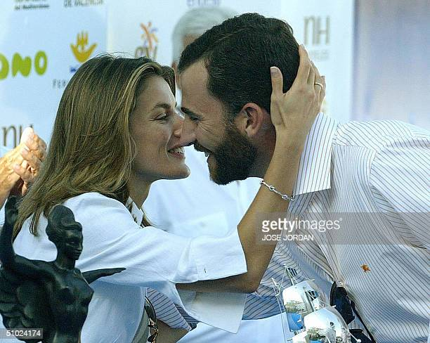 Spanish's Princess Letizia congratulates her husband Prince Felipe of Asturias after he qualified in second position in the Queen's cup boat race off...