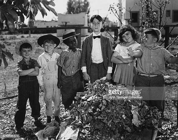 Spanky and the other gang members proudly show Cornelius Smythe whom they think is Alfalfa the clean yard Gang members from left Mickey Percy...