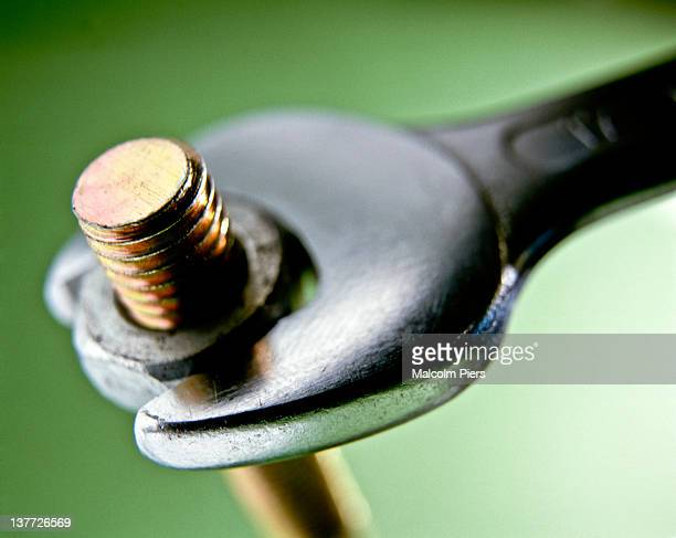 Spanner tightening a nut on a bolt