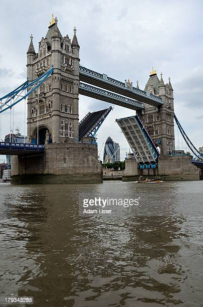 Spanning the famous River Thames, London's iconic Tower Bridge opens/lifts the road bridge bascules. The financial and business district of the City...