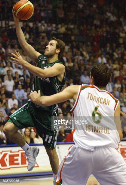 Spanoulis Vasileios of Panathinaikos goes for a basket as Mirsad Turkcan of Ulker Turkey trying to blok him during a Euroleague basketball match at...