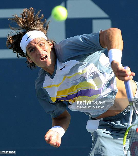 Spansh tennis player Feliciano Lopez serves to Donald Young of the US in their third round match at the US Open in Flushing Meadows New York 01...
