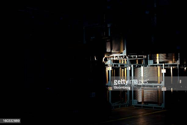 Spare car body parts sit in storage racks at the Saab Automobile plant owned by National Electric Vehicle Sweden AB in Trollhaettan Sweden on Tuesday...