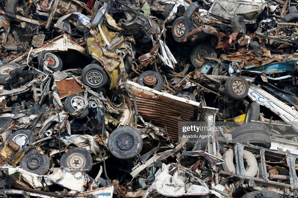 Spare parts of old junk cars are seen after they are