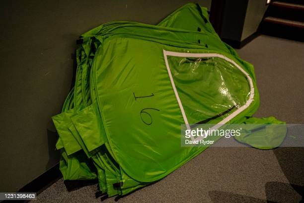 Spare pop-up tents are seen in an auditorium at Wenatchee High School on February 26, 2021 in Wenatchee, Washington. The school has been using pop-up...