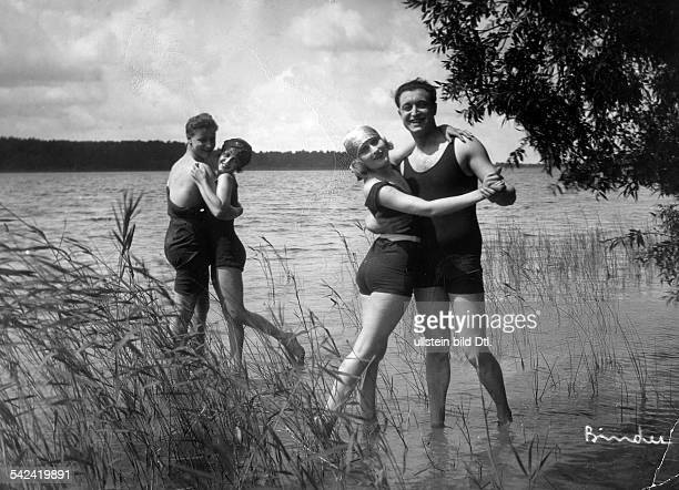 Spare time pictures of the 1920/30ies Two couples dancing in the weed on the shore of a lake on a weekend trip 1926 Photographer Atelier Binder...
