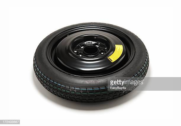 spare tire isolated on white background - spare part stock pictures, royalty-free photos & images