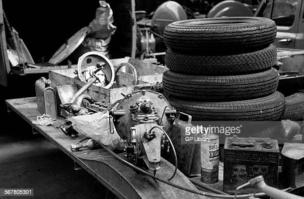 Spare tyres behind the pits race preparation for the Dundrod TT Northern Ireland 1953