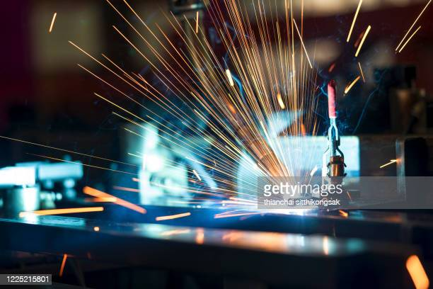 spark from robot industrial welder torch - making stock pictures, royalty-free photos & images