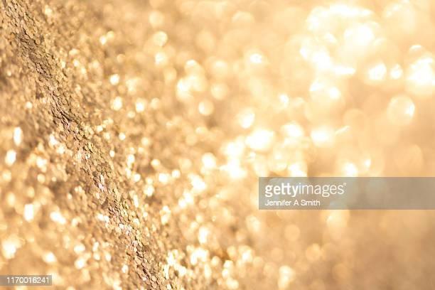sparkle background - or couleur photos et images de collection
