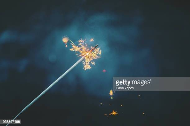 sparkler against black background - diwali stock photos and pictures