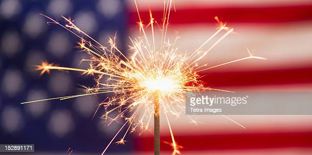 sparkler and american flag - independence day stock pictures, royalty-free photos & images