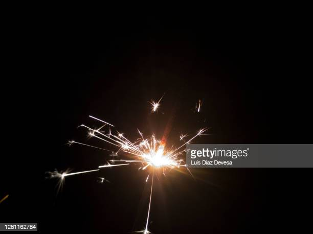 sparkler sparks - sparks stock pictures, royalty-free photos & images