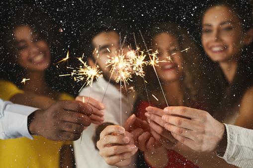 Sparklers background. Young people at celebration party 866491714