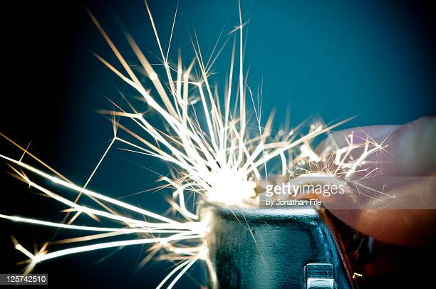 Sparkles coming out of cigarette lighter