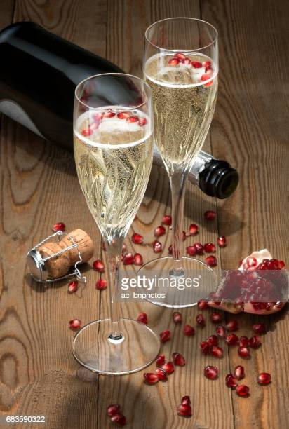 Sparkling Champagne flutes with pomegranate seeds