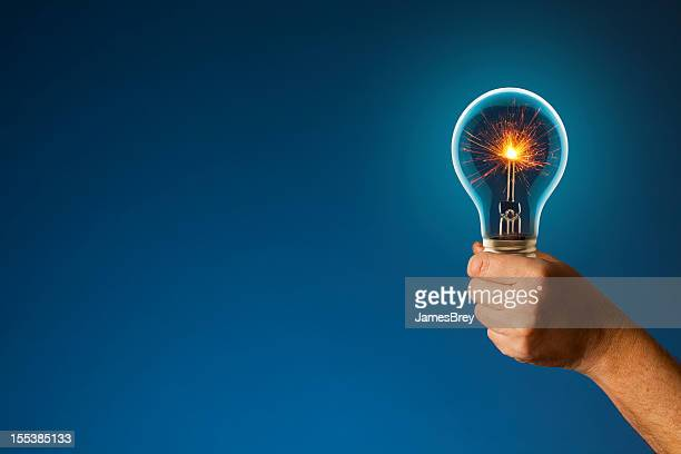 sparkling new idea lighting the way forward - copyright stock photos and pictures