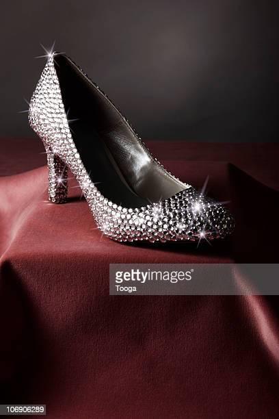 sparkling rhinestone single shoe on pedestal - rhinestone stock pictures, royalty-free photos & images