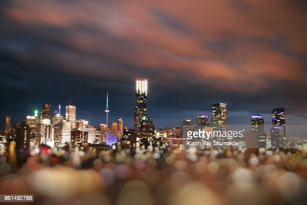 sparkling toronto floating in ocean of bokeh - toronto stock pictures, royalty-free photos & images