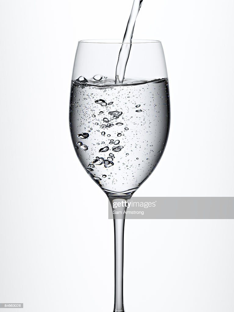 Sparkling Water Pouring Into Wine Glass Stock Photo Getty