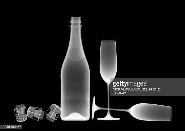 sparkling wine bottle with glasses and corks, x-ray - empty glasses after party stock pictures, royalty-free photos & images