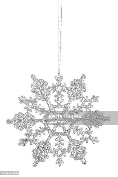 A sparkly silver snowflake ornament