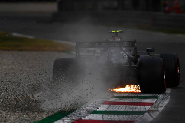 Sparks and gravel fly behind Valtteri Bottas of Finland driving the Mercedes AMG Petronas F1 Team Mercedes W12 during qualifying ahead of the F1...