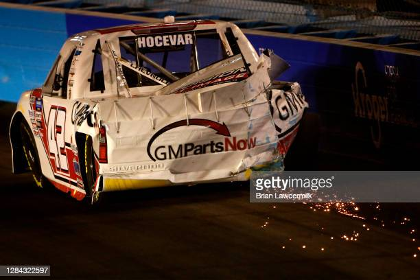 Sparks are seen as Carson Hocevar, driver of the Scott's/GMPartsNow Chevrolet, spins into the wall after an on-track incident during the NASCAR...