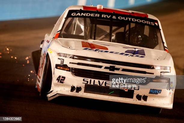 Sparks are seen as Carson Hocevar, driver of the Scott's/GMPartsNow Chevrolet, spins after an on-track incident during the NASCAR Gander RV &...