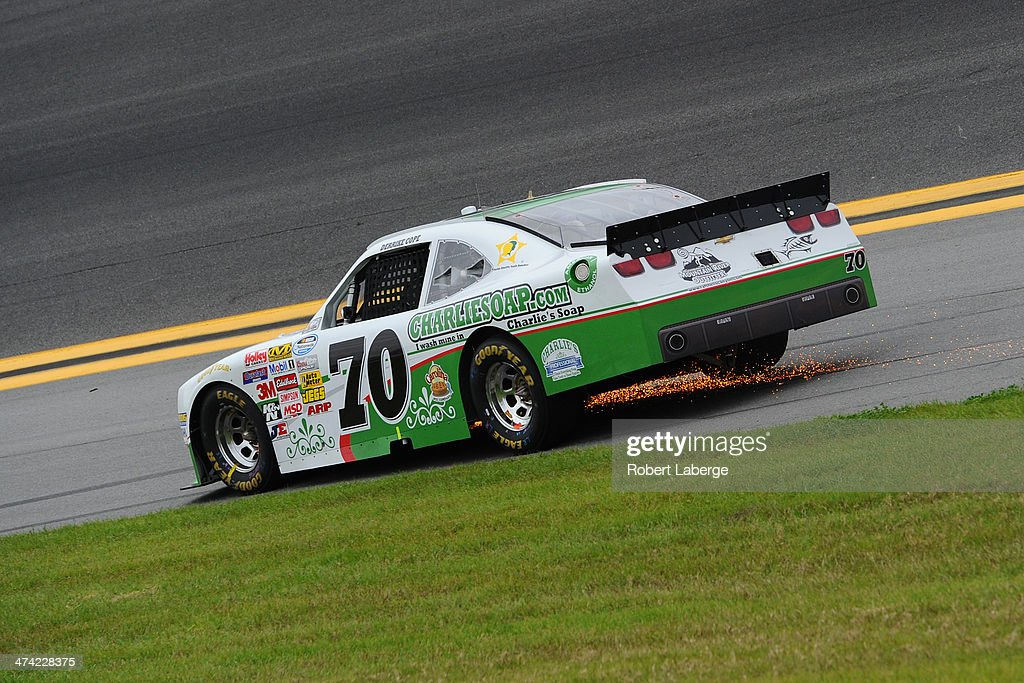 Sparks are seen as Derrike Cope, driver of the #70 Charliesoap.com Chevrolet, races during the NASCAR Nationwide Series DRIVE4COPD 300 at Daytona International Speedway on February 22, 2014 in Daytona Beach, Florida.