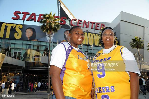 Sparks fans pose for a photo outside before the game between the Phoenix Mercury and the Los Angeles Sparks on June 6 2008 at Staples Center in Los...