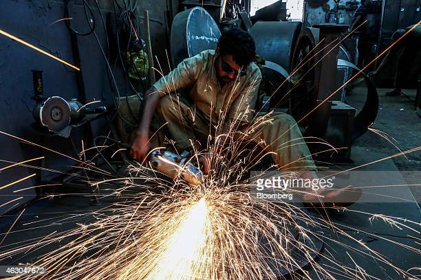 Sparks fly as an employee uses an angle grinder at an Ishwar Engineering Co factory in Mumbai Maharashtra India on Saturday Feb 7 2015 The...