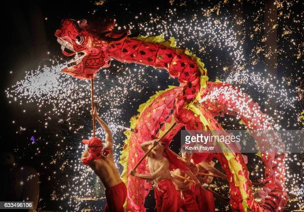 Sparks fly as Chinese dragon dancers perform at a fair at a local park on the fifth day of the Chinese Lunar New Year on February 1 2017 in Beijing...