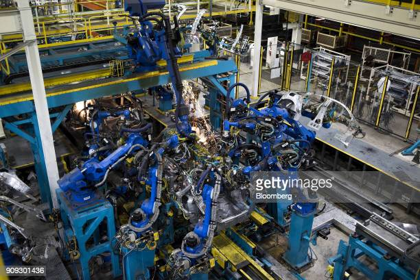 Sparks fly as robotic arms perform inner frame welds for 2018 Honda Accord vehicles during production at the Honda of America Manufacturing Inc...