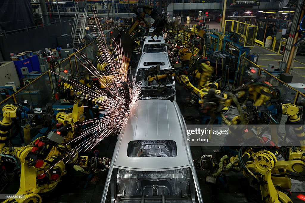 Sparks Fly As Robots Weld The Frames Of Honda Motor Co Odyssey Minivans On  The Assembly