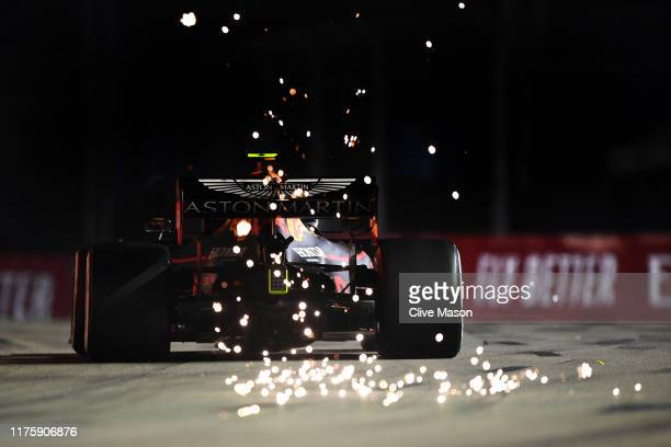 Sparks fly behind Alexander Albon of Thailand driving the Aston Martin Red Bull Racing RB15 on track during practice for the F1 Grand Prix of...