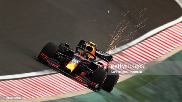 Sparks fly behind Alexander Albon of Thailand driving the Aston Martin Red Bull Racing RB16 during practice for the F1 Grand Prix of Hungary at...