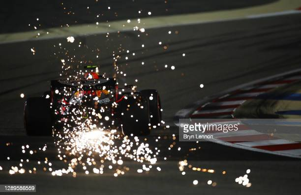 Sparks fly behind Alexander Albon of Thailand driving the Aston Martin Red Bull Racing RB16 during qualifying ahead of the F1 Grand Prix of Sakhir at...