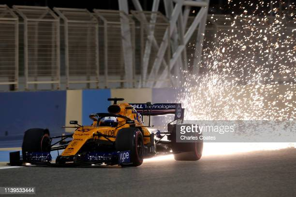 Sparks fly behind Carlos Sainz of Spain driving the McLaren F1 Team MCL34 Renault on track during the F1 Grand Prix of Bahrain at Bahrain...
