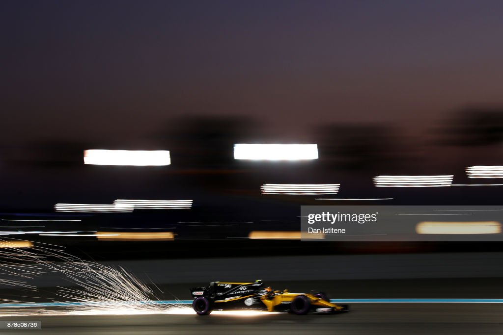 Sparks fly behind Carlos Sainz of Spain driving the (55) Renault Sport Formula One Team Renault RS17 on track during practice for the Abu Dhabi Formula One Grand Prix at Yas Marina Circuit on November 24, 2017 in Abu Dhabi, United Arab Emirates.