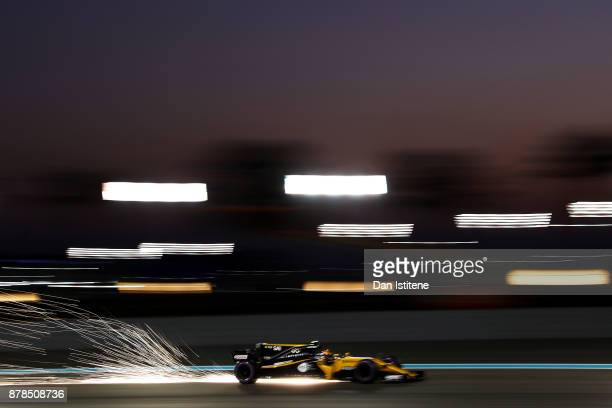 Sparks fly behind Carlos Sainz of Spain driving the Renault Sport Formula One Team Renault RS17 on track during practice for the Abu Dhabi Formula...