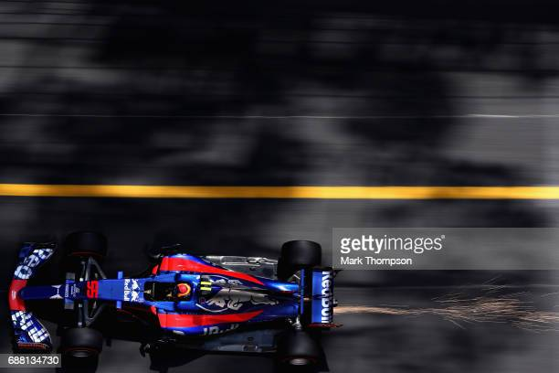 Sparks fly behind Carlos Sainz of Spain driving the Scuderia Toro Rosso STR12 on track during practice for the Monaco Formula One Grand Prix at...