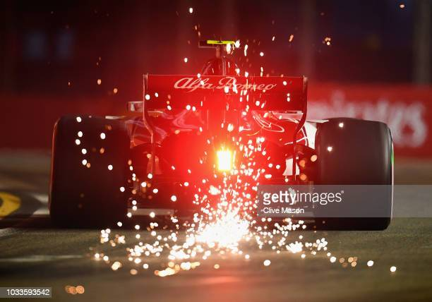 Sparks fly behind Charles Leclerc of Monaco driving the Alfa Romeo Sauber F1 Team C37 Ferrari on track during qualifying for the Formula One Grand...