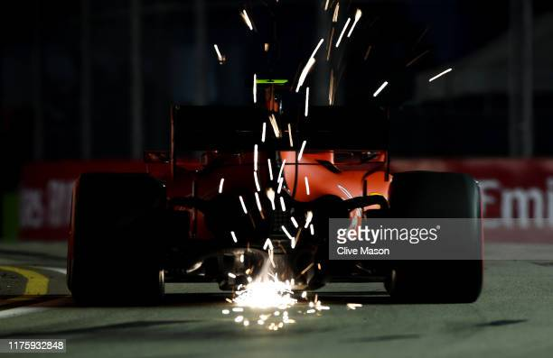 Sparks fly behind Charles Leclerc of Monaco driving the Scuderia Ferrari SF90 during practice for the F1 Grand Prix of Singapore at Marina Bay Street...