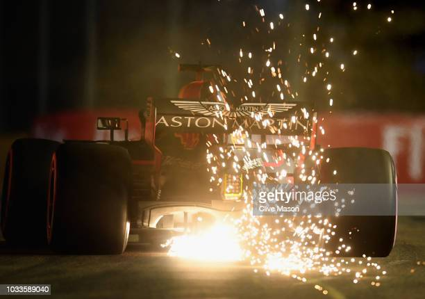 Sparks fly behind Daniel Ricciardo of Australia driving the Aston Martin Red Bull Racing RB14 TAG Heuer on track during qualifying for the Formula...