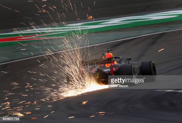 Sparks fly behind Daniel Ricciardo of Australia driving the Aston Martin Red Bull Racing RB14 TAG Heuer on track during practice for the Formula One...