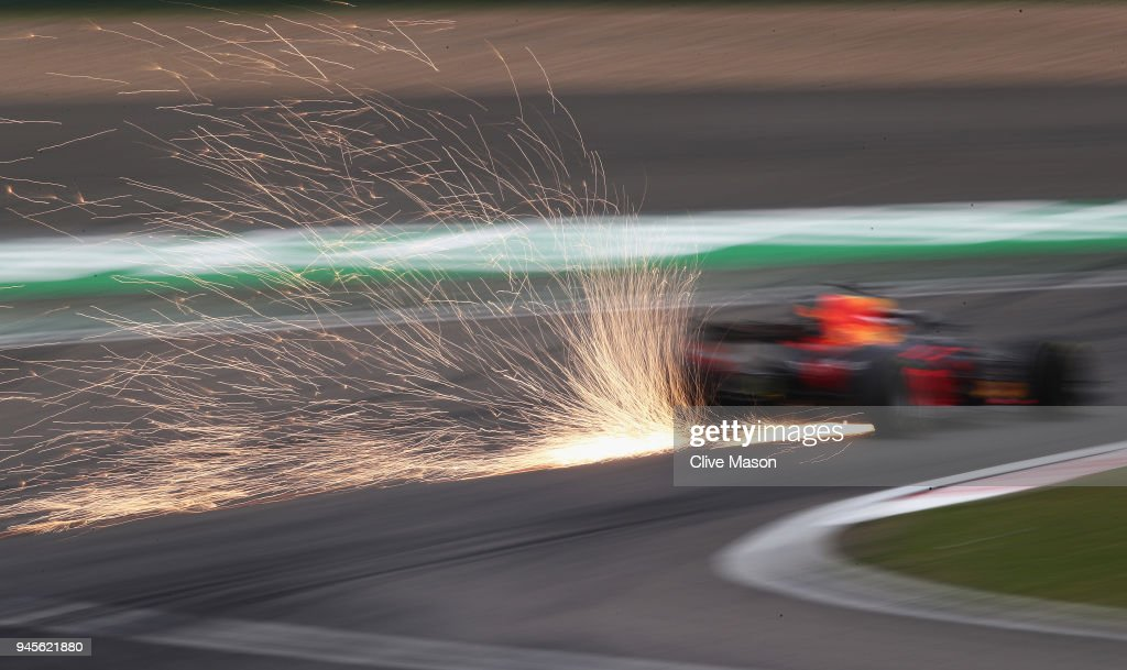 Sparks fly behind Daniel Ricciardo of Australia driving the (3) Aston Martin Red Bull Racing RB14 TAG Heuer on track during practice for the Formula One Grand Prix of China at Shanghai International Circuit on April 13, 2018 in Shanghai, China.